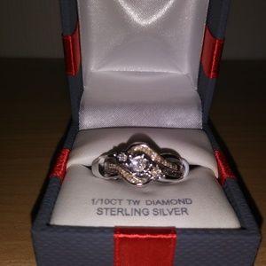 Jewelry - Brand new 1/10 ct tw diamond ring set on sterling
